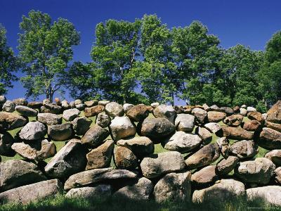 Stone Wall with Trees in the Background