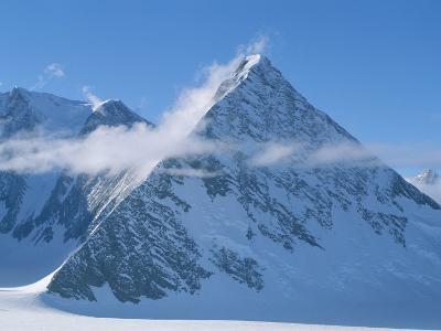 A Cloud Passes by Windblown Pyramid Peak, in Antarctica