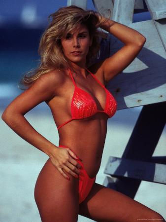 Woman in Bikini Standing Near Lifeguard Stand