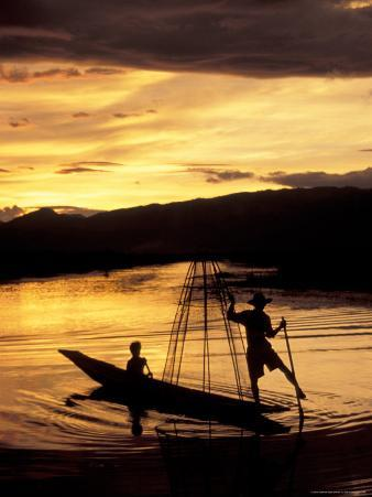 Intha Fisherman Rowing Boat With Legs at Sunset, Myanmar