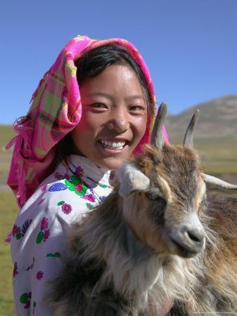 Tibetan Girl Holding Sheep in the Meadow, East Himalayas, Tibet, China