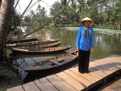 Woman Near Old Boats, Mekong Delta, Vietnam