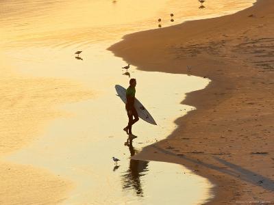 Surfer at Blackhead Beach, South of Dunedin, South Island, New Zealand