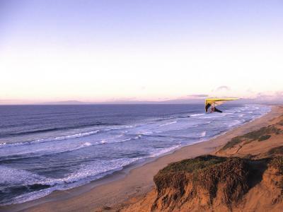 Hang Gliding off Beach in Monterey, California, USA