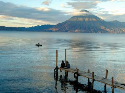 Sunrise over Lake Atitlan and Women on End of the Pier, Solola, Guatemala