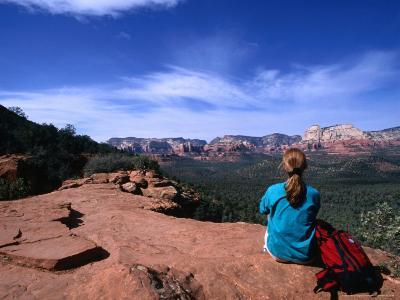 A Hiker Taking in the Views of Red Rock Wilderness in Sedona, Sedona, Arizona, USA