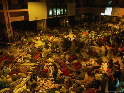 Railway Station Hall at Night Packed with Sleeping Pilgrims, Varanasi, Uttar Pradesh, India