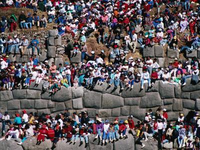 Spectators Sitting on Inca Walls Watching Inti Raymi Festival, Sacsayhuaman, Cuzco, Peru