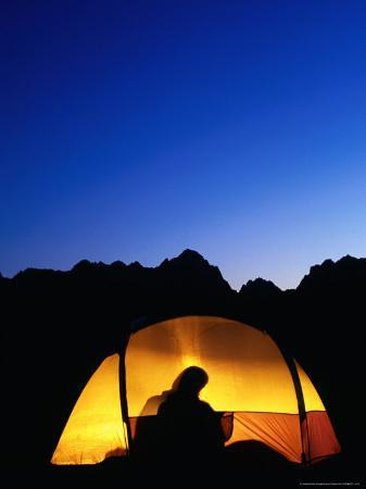 Camper Reading by Lantern in Tent at Dusk, Yosemite National Park, USA