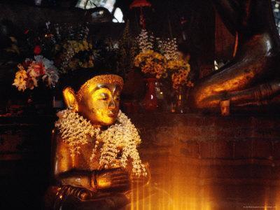 Buddha Statue at Theindawgyi Wearing a Garland of Orchids, Myeik, Myanmar (Burma)