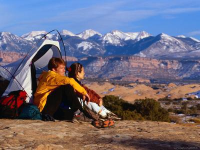 Couple Camping at Slickrock with Snow-Capped Peaks in the Background, Utah, USA