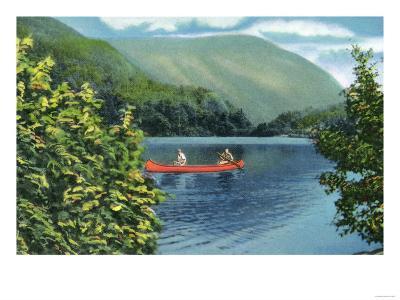White Mountains, New Hampshire - Couple Canoeing on a Lake
