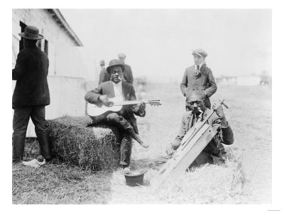 Men Playing Kazoos and Guitar Photograph