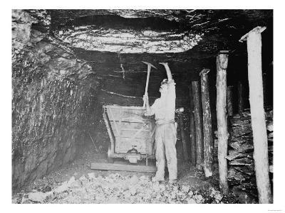 Miner Working in a Coal Mine Photograph