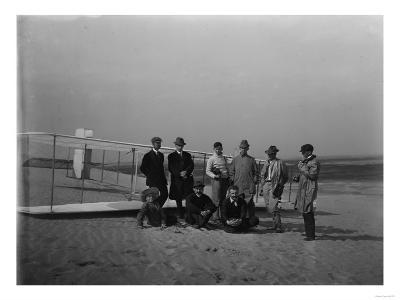Group portrait in front of glider at Kill Devil Hill Photograph - Kitty Hawk, NC