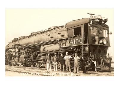 Photo of Men Standing in Front of Caboose