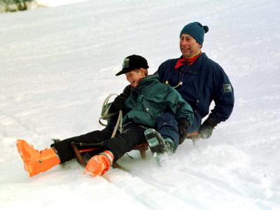 Prince Charles on a Sledge with Prince Harry While on Holiday in Klosters Switzerland January 1997