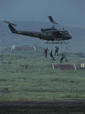 Soldiers Rappel From a Helicopter During Training Exercises