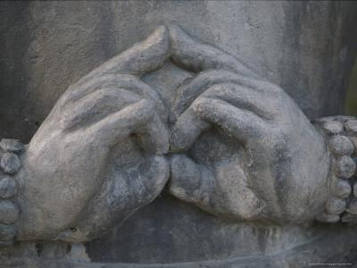 Close View of a Buddhist Statue's Hands