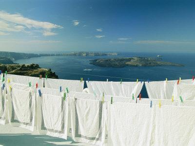 Laundry Hanging Out To Dry with a Scenic Hilltop View of the Water