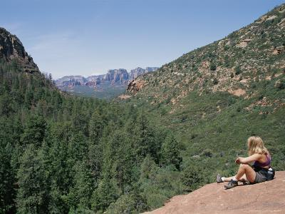 Hiker Relaxes Near Vultee Arch in the Secret Mountain Wilderness