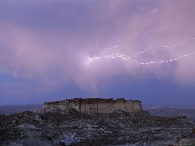 Lightning Strikes Above a Butte in Adobe Town in Wyoming's Red Desert
