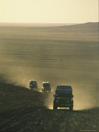 Land Rovers Kick Up Dust on the Old Caravan Road To Ghat