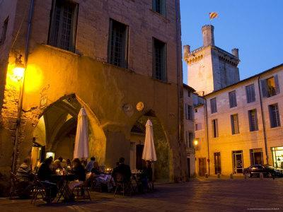 Outdoor Dining in Uzes, with Duche D'Uzes Illuminated at Dusk