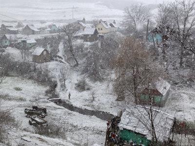 Winter Snows Begin to Fall on Village, Transylvania