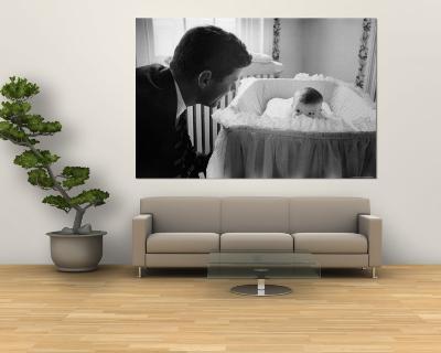 Sen. Jack Kennedy Admiring Baby Caroline as She Lies in Her Crib in Nursery at Georgetown Home