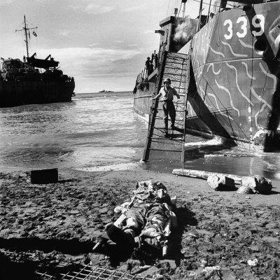 US Soldier Descending Towards Australian Serviceman Killed by Japanese Air Raid Attacks