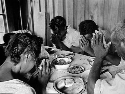 Delta and Pine Company African American Sharecropper Lonnie Fair and Family Praying before a Meal