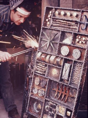 Maker of Metal Furniture, Paul Evans, Hope, PA., Burnishes Door of Steel Chest with Acetylene Torch