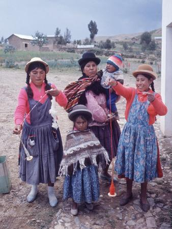 Mother and Four Children Wearing Derby Hats, Playing with Ball of Yarn, Andean Highlands of Bolivia