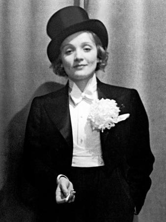 Actress Marlene Dietrich Wearing Tuxedo, Top Hat, and Holding Cigarette at Ball for Foreign Press