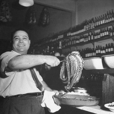 Cook in the Napoli Restaurant Holding up an Octopus, a Delicacy in Argentina