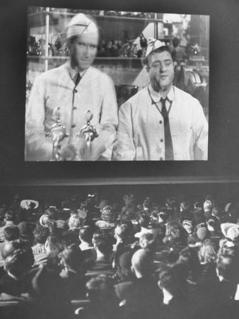 """Audience at Omaha Theater Watching Abbott and Costello in Feature Picture """"Who Done It"""""""
