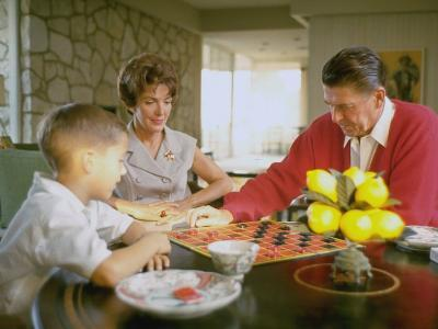 CA Gov. Candidate Ronald Reagan, Wife Nancy and Son Sitting at Table Playing Checkers at Home