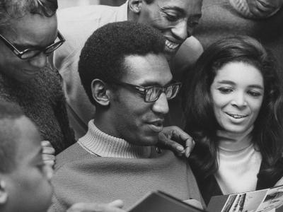 Comedian Bill Cosby Scanning Family Scrapbook with His Wife Camille and Mother