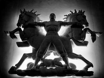 Statue of Man and Horses Being Lit from Behind at the New York World's Fair