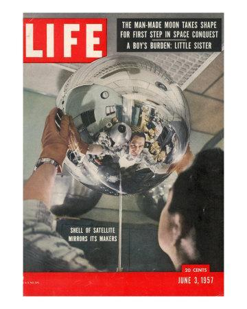 Naval Research Lab Worker Examining Shell of a Satellite, June 3, 1957