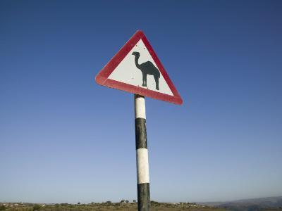 Oman, Dhofar Region, Salalah, Camel Crossing Sign in the Dhofar Mountains