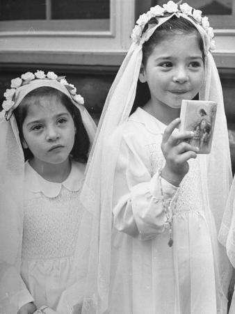 Two Dionne Quintuplets Posing in their Outfits for their First Communion