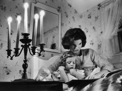 Jackie Kennedy Reading a Bedtime Story to Her Young Daughter Caroline at the Kennedy Family Home