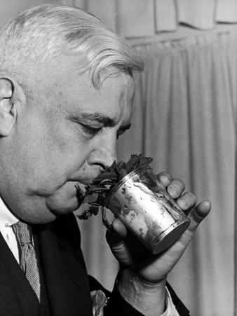 Man Sipping Mint Julep at Kentucky Derby Party