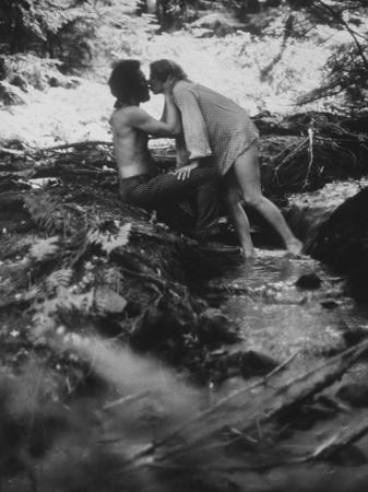 Hippie Couple Kissing at Woodstock Music Festival