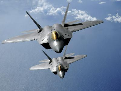 Two F-22 Raptors Fly over the Pacific Ocean
