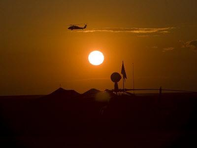 UH-60 Blackhawk Flies over Camp Speicher Airfield at Sunset