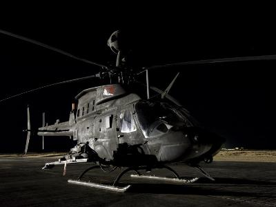 OH-58D Kiowa Sits on its Pad at Night