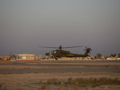 AH-64 Apache Hovering Above the Ramp, Tikrit, Iraq